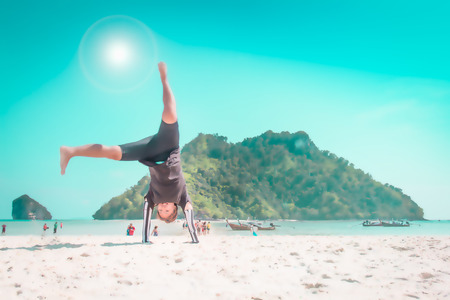 somersault: Blurred happy woman with somersault on the beach : Can use for mantage or display your product. Stock Photo