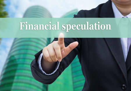speculation: Businessman pointing to Financial speculation concept. Stock Photo