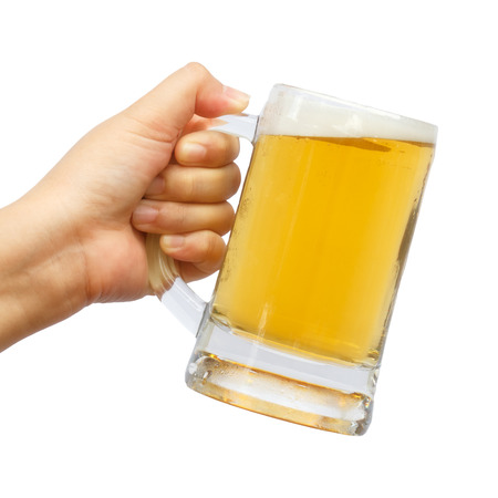 international beer: International beer day with hand holding glass beer on isolated background.