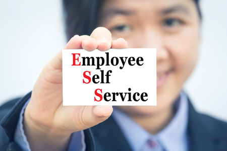 ess: Businesswoman holding card with Employee Self Service (ESS) message.