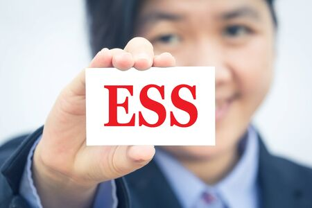 ess: Businesswoman holding card with  ESS (Employee Self Service) message. Stock Photo