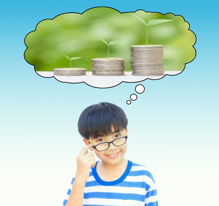 approximate: Boy planing for save money or growing business idea concept on vintage tone.