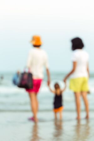 blurr: Abstract blurred family take care baby on the beach.