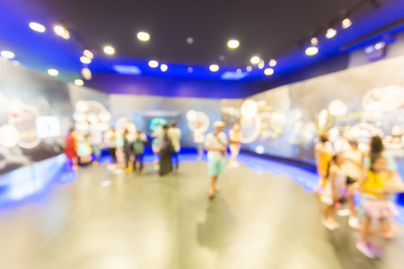 business lifestyle: Blurred people walking in the exhibition hall. Stock Photo