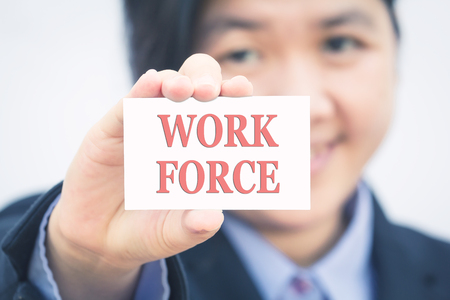 work force: Businesswoman holding card with WORK FORCE message.