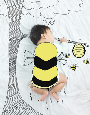 illustration draw on adorable baby girl is bee flying for honey. Stock Photo