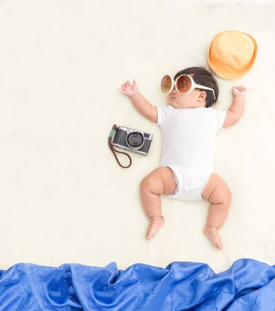 Adorable asian baby girl sleep on blanket with summer concept.