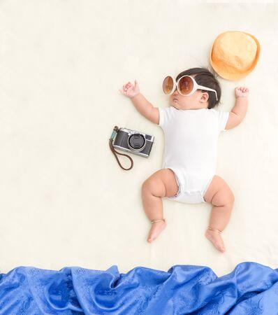 Adorable asian baby girl sleep on blanket with summer concept.