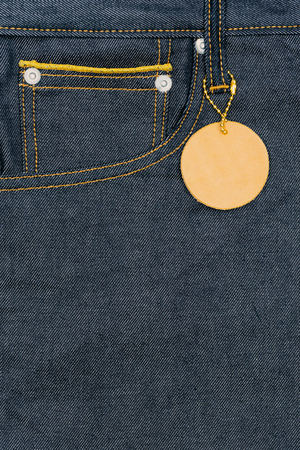 leather label: Plank leather label on pocket blue jean denim with copy space.