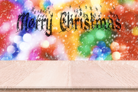 Plank wood or table top with merry christmas message and blur ornament background. Can use for montage or made marketing your product. Banco de Imagens