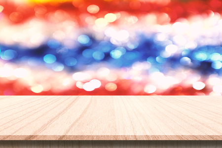 Plank wood or table top with blur christmas ornament background. Can use for montage or made marketing your product.