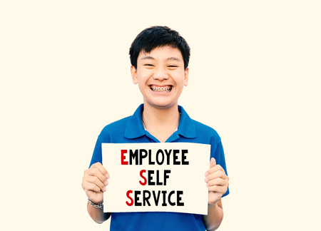 Asian teen holding paper with Employee Self Service (ESS) message with vintage tone. Stock Photo