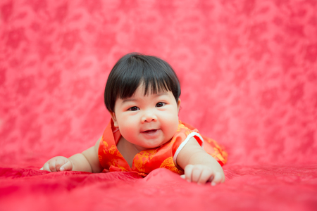 Adorable asian baby girl on chinese new year theme. 스톡 콘텐츠