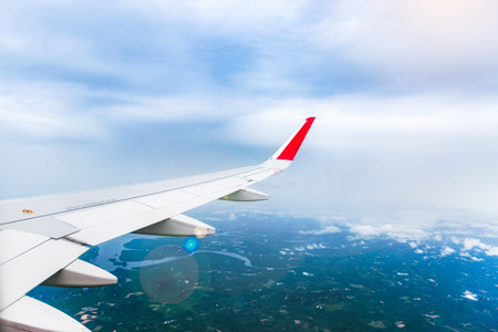Air plane wing over the land. Can use for airline transportation background. Stock Photo