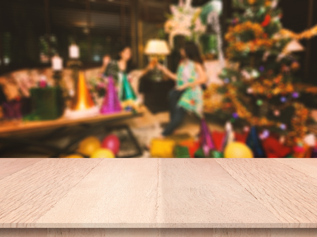 Plank wood or table top with blurred celebration christmas party background. Can use for display or marketing your product background. Banco de Imagens