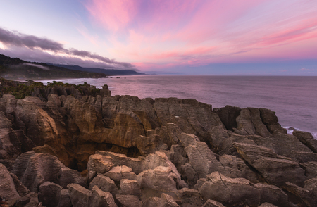 Pancake rock with beatiful sky, This is famous landmark in Punakaiki New Zealand.