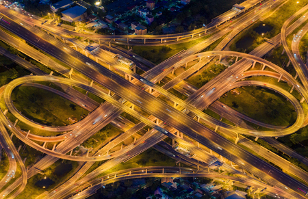 Aerial view highway road intersection for transportation, distribution import export or distribution background.