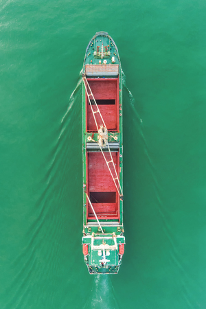Aerial view empty container ship to sea port and working crane bridge loading container for import  export or transportation concept background.