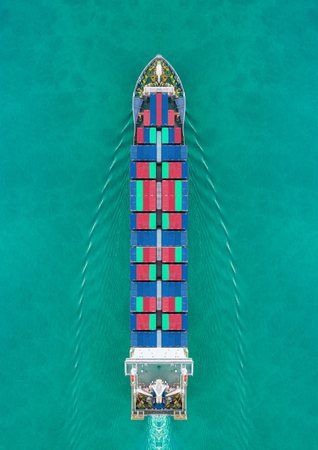 Aerial view container ship driving on the sea for delivery containers shipment. Suitable use for transport or import export to global logistics concept. Stok Fotoğraf