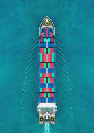 Aerial view container ship driving on the sea for delivery containers shipment. Suitable use for transport or import export to global logistics concept. Zdjęcie Seryjne