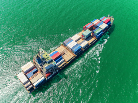 Aerial top view container ship at sea port  loading container for import export, shipping or transportation. Stok Fotoğraf