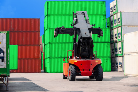 Forklift truck working in container warehouse for logistics shipping, import export or transportation.