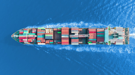 Aerial top view container ship on the sea full speed transport container for logistics import export or shipping background. Standard-Bild