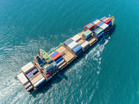 Aerial top view container ship at sea port  loading container for import export, shipping or transportation. 版權商用圖片