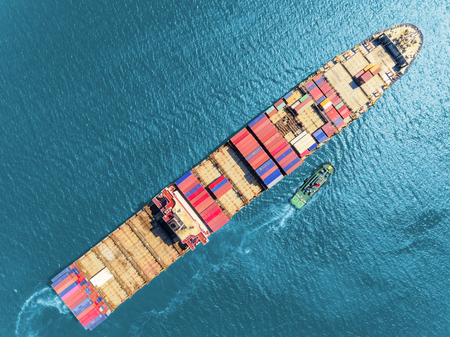 Aerial top view container ship at sea port for import export, shipping or transportation concept background. 版權商用圖片