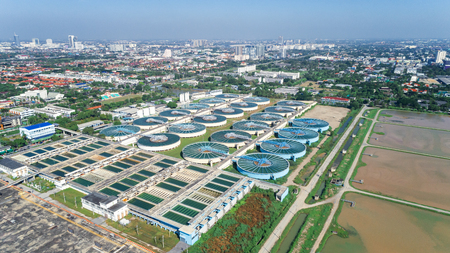 Aerial view water treatment plant with cityscape for environment concept.