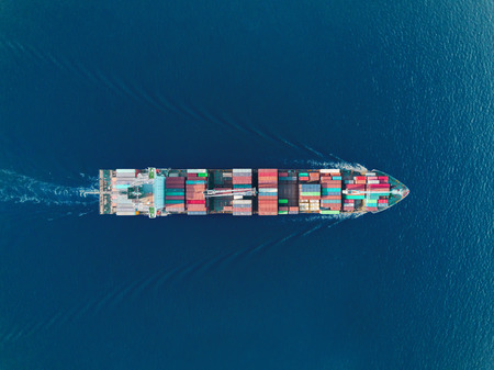 Aerial top view container ship on the sea full speed transport container for logistics import export or shipping background. 版權商用圖片