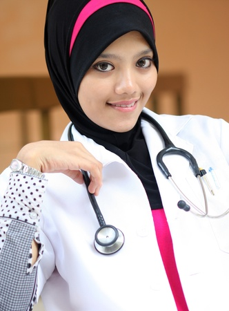 A young muslim woman doctor smiling Imagens
