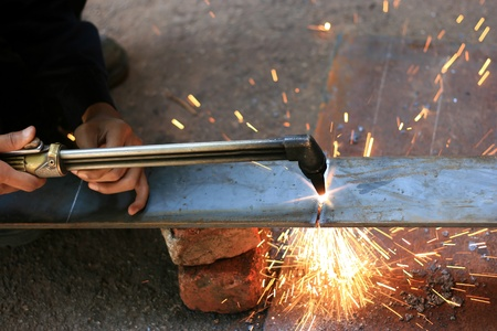 gas cuting torch with flame cut the metal photo