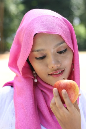 Portrait of muslim woman with apple  Stock Photo - 10754882