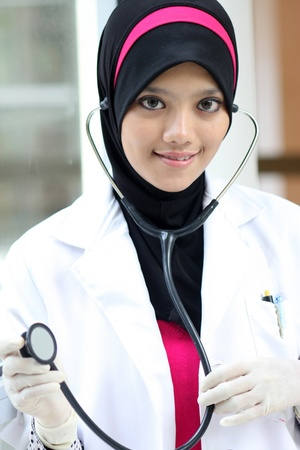 A young muslim woman doctor with stethoscope photo