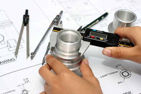 drafting: Hand with technical drawing and tools