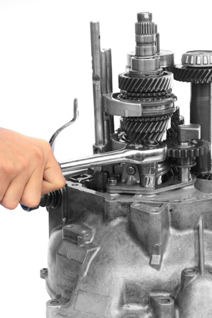 Hand with ratchet handle and mechanical gear on isolated white background  photo