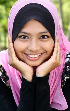 Portrait of beautiful thoughtful muslim woman  photo