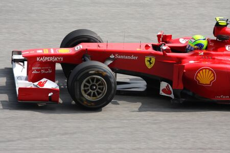 massa: SEPANG, MALAYSIA - MARCH 23: Close up Felipe Massa of Ferrari in action at PETRONAS Malaysian Grand Prix practice session on 23 March, 2012 in Sepang, Malaysia.