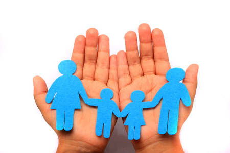close up of child cupped hands showing cotton family  Imagens