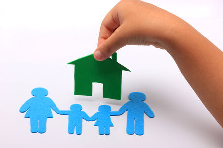 hand with family icon and green house photo