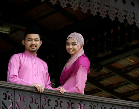 house robes: Muslim couple with greeting Hari Raya