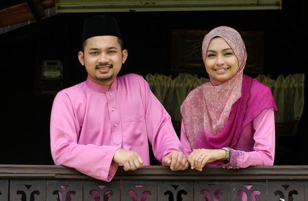 Muslim couple with greeting Hari Raya