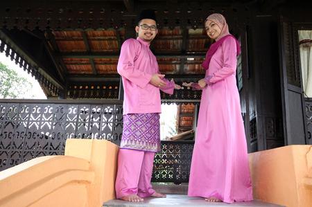 aidilfitri: Muslim couple with greeting Hari Raya
