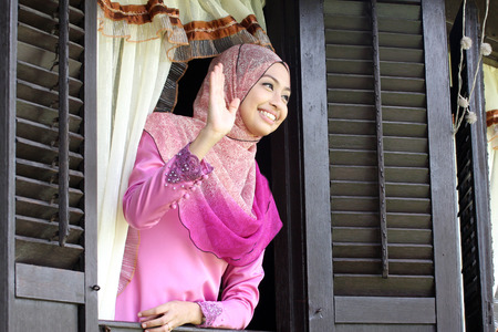 aidilfitri: Malay muslim woman at  traditional window house Stock Photo