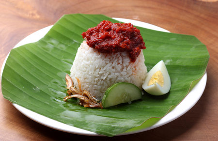 Nasi Lemak, a famous Malaysian food served on banana leaf