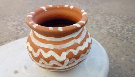 Such vessels are traditionally made by potter in India. Painting done on clay pot makes the pot more beautiful.
