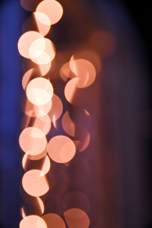 abstract gold and orange background with soft creamy blurry bokeh light effect