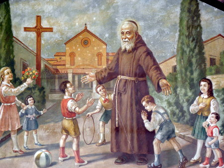 leopold: Painting on a wall representing St. Leopold Mandic with the children, his sanctuary in Padua, Italy. Editorial