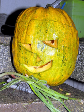 scarry: A scarry but smiling Halloween pumpkin.